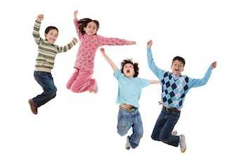 Four children jumping isolated on a white background